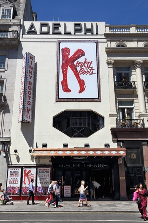 west end: LONDON, UK - JULY 6, 2016: People walk by Adelphi Theatre in London, UK. It is one of London West End theatres. In 2013 West End theatres sold 14.5 million tickets. Editorial