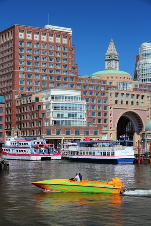 BOSTON, USA - JUNE 9, 2013: People ride a motorboat in Boston, USA. Boston is the largest city in Massachusetts with estimated 2014 population of 645,966.