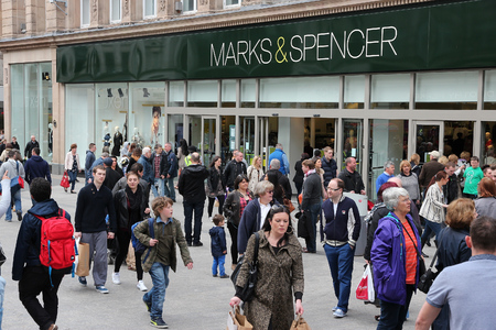 spencer: LIVERPOOL, UK - APRIL 20, 2013: People visit Marks & Spencer in Liverpool, UK. M&S is a major retailer with 1,010 stores in 41 countries. It specializes in fashion and luxury goods.