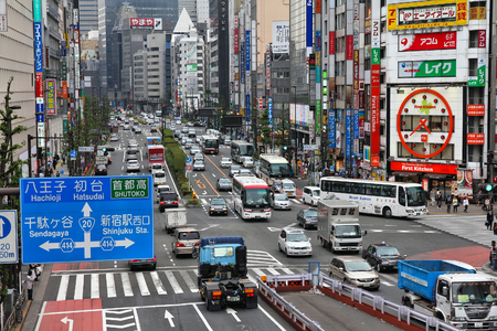 TOKYO, JAPAN - MAY 8, 2012: People drive in Shinjuku, Tokyo, Japan. The Greater Tokyo Area is the most populous metropolitan area in the world (38 million people).