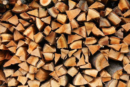 firewood: Stacked firewood - pile of chopped fire wood logs. Rural home concept.