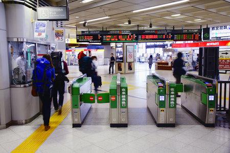 schlagbaum: UTSUNOMIYA, JAPAN - 5 MAY, 2012: Passengers enter Utsunomiya Station in Japan. Utsunomiya is an important railway hub. The station was opened in 1885.