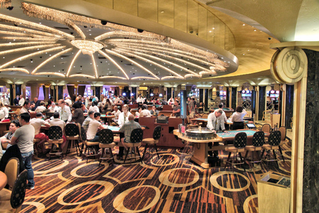 blackjack: LAS VEGAS, USA - APRIL 14, 2014: People play games at Bellagio resort in Las Vegas. The famous casino resort has almost 4,000 rooms. Editorial