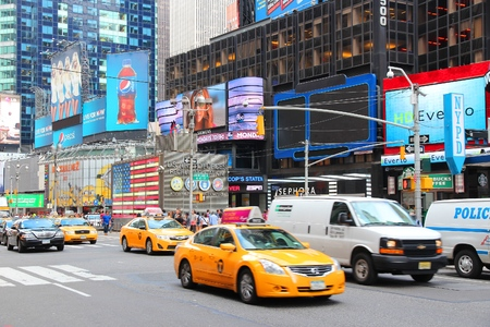 new york times: NEW YORK, USA - JULY 2, 2013: Taxis drive along Times Square in New York. Times Square is one of most recognized landmarks in the world. More than 300,000 people pass through Times Square daily.