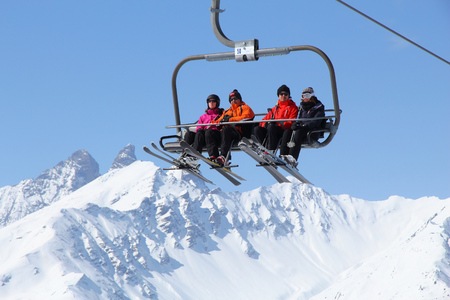station ski: VALLOIRE, FRANCE - MARCH 23, 2015: Skiers go up the lift in Galibier-Thabor station in France. The station is located in Valmeinier and Valloire and has 150km of ski runs.