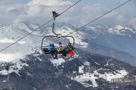 station ski: VALLOIRE, FRANCE - MARCH 24, 2015: Skiers go up the lift in Galibier-Thabor station in France. The station is located in Valmeinier and Valloire and has 150km of ski runs. Editorial