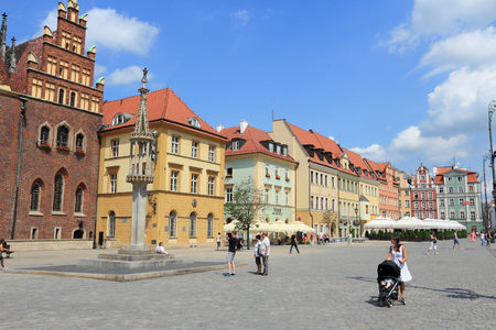 WROCLAW, POLAND - JULY 6, 2014: People visit Rynek (Market Square) in Wroclaw. Wroclaw is the 4th largest city in Poland with 632,067 people (2013). Editorial