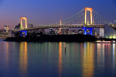 megacity: Rainbow Bridge in Tokyo, Japan. Night city view with Shibaura district.