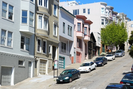 SAN FRANCISCO, USA - APRIL 9, 2014: Cars parked in the steep streets of San Francisco, USA. San Francisco is the 4th most populous city in California (837,442 people in 2013).