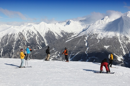 BAD GASTEIN, AUSTRIA - MARCH 9, 2016: People ski in Bad Gastein. It is part of Ski Amade, one of largest ski regions in Europe with 760km of ski runs.