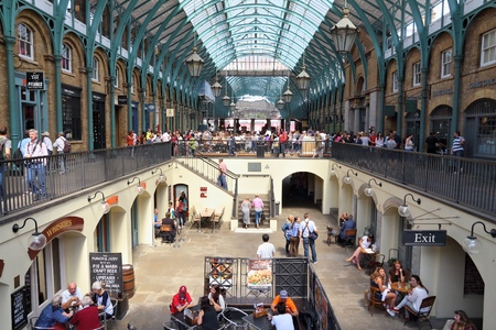 covent garden market: LONDON, UK - JULY 6, 2016: People visit Covent Garden Apple Market in London, UK. London is the most populous city in the UK with 13 million people living in its metro area.