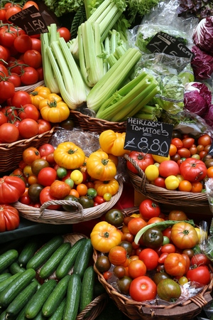 retailer: London Borough Market - tomatos and celery at a marketplace stall.