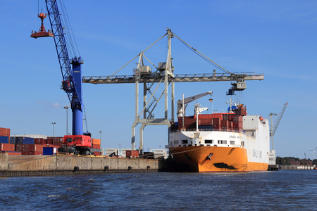 HAMBURG, GERMANY - AUGUST 28, 2014: Grande Buenos Aires of Grimaldi Lines is loaded in Port of Hamburg. The seaport is the 15th busiest in the world in terms TEU throughput (2011). Editorial