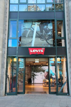 levi: BERLIN, GERMANY - AUGUST 27, 2014: Levis fashion store at (KuDamm) Avenue in Berlin. Levi Strauss & Co is a denim brand with 2,800 stores worldwide.
