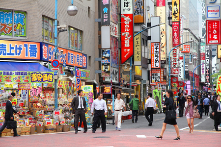 hectic life: TOKYO, JAPAN - MAY 8, 2012: People shop in Shinjuku, Tokyo, Japan. The Greater Tokyo Area is the most populous metropolitan area in the world (38 million people). Editorial