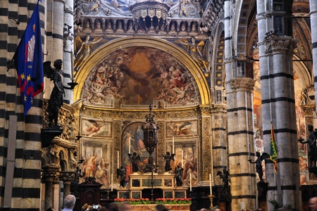 SIENA, ITALY - MAY 3, 2015: Interior view of the Cathedral in Siena, Italy. The Medieval Roman Catholic cathedral was consecrated circa year 1215. Editorial