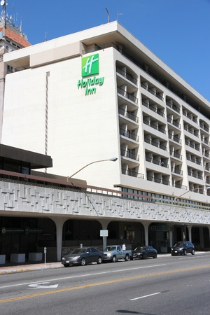 establishment states: FRESNO, UNITED STATES - APRIL 12, 2014: Holiday Inn hotel in Fresno, California. Holiday Inn is a part of InterContinental Hotels Group and has 3,414 locations.