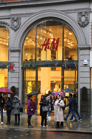 famous industries: LONDON, UK - APRIL 22, 2016: People shop at H&M (H and M) in London, UK. H&M is famous for its fast-fashion approach. It has 4,000 stores globally. Editorial