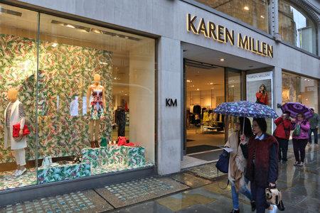 LONDON, UK - APRIL 22, 2016: People shop at Karen Millen in London, UK. Karen Millen is a British fashion retailer owned by Kaupthing Bank.