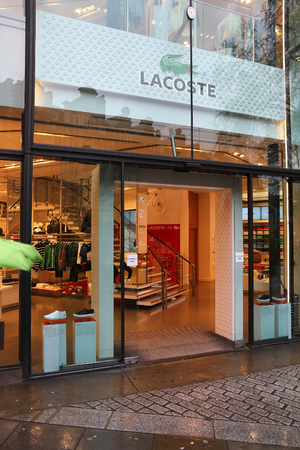 LONDON, UK - APRIL 22, 2016: People shop at Lacoste in London, UK. Lacoste is present in 112 countries. It exists since 1933 and has 1,000 stores.