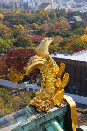 osakajo: Osaka Castle - landmark of Japan. Gold fish sculpture.