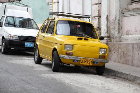 SANTIAGO, CUBA - FEBRUARY 8, 2011: Parked oldtimer Polski Fiat 126p car in Santiago de Cuba. Cuba has one of the lowest car-per-capita rates (38 per 1000 people in 2008).