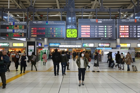 TOKYO, JAPAN - DECEMBER 3, 2016: Passengers hurry in Shinagawa Station in Tokyo. The station was used by 335,661 passengers daily in 2013. Editorial