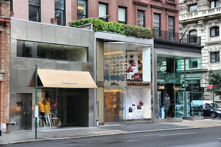 madison: NEW YORK, USA - JULY 1, 2013: Stores along Madison Avenue in New York. Madison Avenue is one of the most recognized fashion shopping destination in the world. Editorial