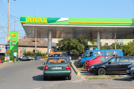 SIBIU, ROMANIA - AUGUST 24, 2012: Drivers fill up their cars on Aral station in Sibiu, Romania. Aral runs 2,400 stations internationally and has 600 million customers annually.