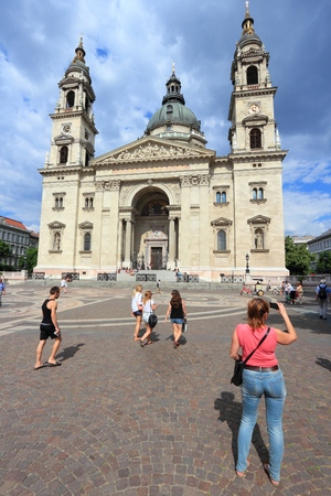 BUDAPEST, HUNGARY - JUNE 19, 2014: People visit Saint Stephens Basilica in Budapest. It is the largest city in Hungary and 9th largest in the EU (3.3 million people).