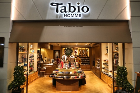 KYOTO, JAPAN - NOVEMBER 27, 2016: People visit Tabio Homme socks store in Kyoto, Japan. Retail sales amounted to137.6 trillion yen in Japan in 2012.