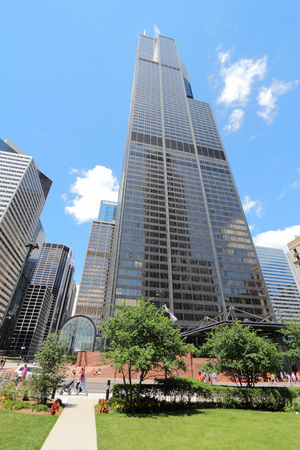 sears: CHICAGO, USA - JUNE 28, 2013: People walk by Willis Tower (formerly Sears Tower) in Chicago. It is 442m tall and as of 2013 is the 2nd tallest building in the USA.