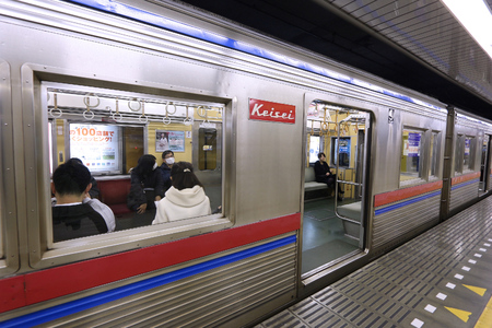 oshiage: TOKYO, JAPAN - NOVEMBER 30, 2016: People board Keisei train at Oshiage station in Tokyo, Japan. Keisei Electric Railway operates 152 km of railway lines. Editorial