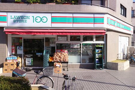 TOKYO, JAPAN - NOVEMBER 30, 2016: Lawson 100 grocery store in Tokyo, Japan. Lawson 100 is a budget convenience store brand where most items are priced 100 yen.