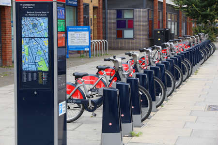 shared sharing: LONDON, UK - JULY 8, 2016: Santander Cycles bicycle hire station in Shoreditch, London, UK. The public bike hire network has 839 stations and 13,600 bicycles. Editorial