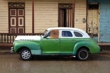 capita: BARACOA, CUBA - FEBRUARY 14, 2011: Classic old car parked in the street in Baracoa, Cuba. Cuba has one of the lowest car-per-capita rates (38 per 1000 people in 2008). Editorial