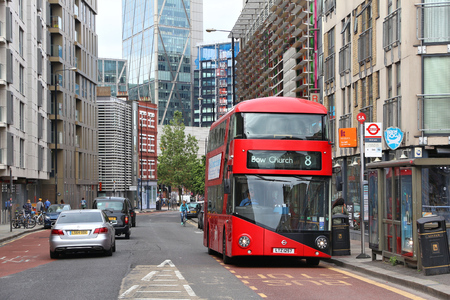 LONDON, UK - JULY 9, 2016: People ride New Routemaster bus in City of London. The hybrid diesel-electric bus is a new, modern version of iconic double decker. Editorial