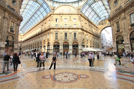 prestigious: MILAN, ITALY - OCTOBER 6, 2010: People visit Vittorio Emmanuele II historic shopping gallery in Milan, Italy. Inaugurated in 1865, the gallery claims to be the oldest shopping center worldwide. Editorial