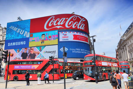 LONDON, UK - JULY 7, 2016: People visit Piccadilly Circus in London. London is the most populous city in the UK with 13 million people living in its metro area. Editorial