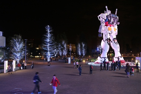 TOKYO, JAPAN - DECEMBER 2, 2016: People visit Mobile Suit Gundam gigantic robot statue in Odaiba, Tokyo. The 18-meters-tall anime robot will be replaced by a bigger one in 2017.