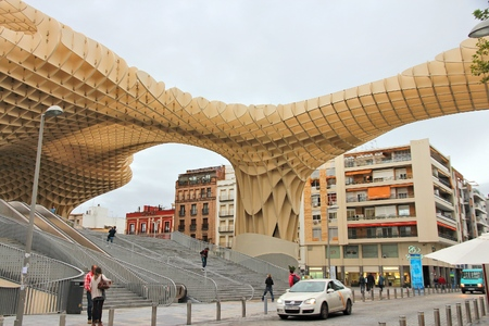 SEVILLE, SPAIN - NOVEMBER 4, 2012: People visit Metropol Parasol building in Seville, Spain. Metropol Parasol claims to be the largest wooden structure in the world. Editöryel