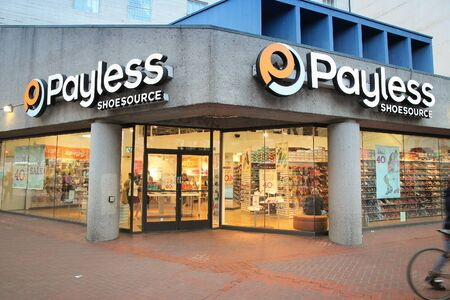 SAN FRANCISCO, USA - APRIL 8, 2014: Shoppers visit Payless Shoesource footwear store in San Francisco, USA. Payless went bankrupt in 2017.