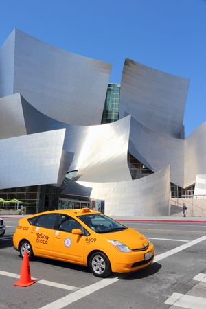 LOS ANGELES, USA - APRIL 5, 2014: Person visits Walt Disney Concert Hall in Los Angeles. The famous landmark was designed by Frank Gehry. Editorial