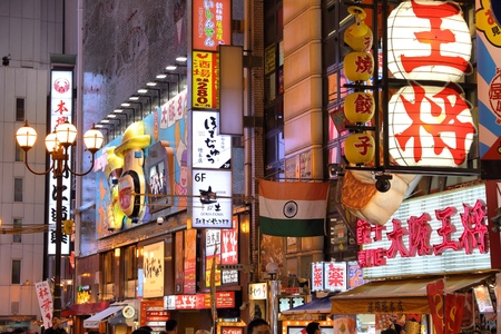 OSAKA, JAPAN - NOVEMBER 21, 2016: Neon lights of Dotonbori street in Osaka, Japan. Dotonbori is the main entertainment area of Osaka. Редакционное