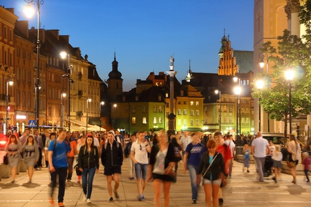 WARSAW, POLAND - JUNE 18, 2016: People visit Krakowskie Przedmiescie street in Old Town in Warsaw, Poland. Warsaw is the capital city of Poland. 1.7 million people live here.