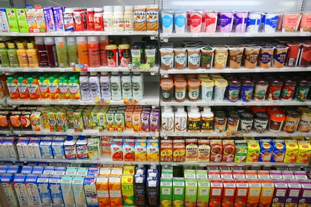 dole: TOKYO, JAPAN - NOVEMBER 29, 2016: Drink shelf of a convenience store in Tokyo, Japan. There are more 42,000 convenience stores in Japan.