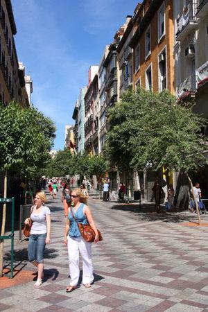 inhabitants: MADRID, SPAIN - SEPTEMBER 2, 2009: Shoppers visit Calle de la Montera in Madrid. Madrid is the Spanish capital city with 3,165,235 inhabitants. Editorial