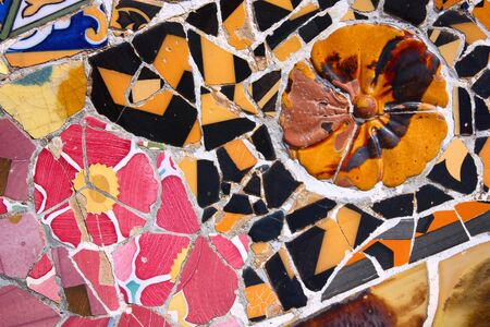 trencadi: Barcelona art - Park Guell colorful ceramic mosaic background.