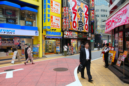 TOKYO, JAPAN - MAY 8, 2012: People shop in Shinjuku, Tokyo, Japan. The Greater Tokyo Area is the most populous metropolitan area in the world (38 million people). Editorial