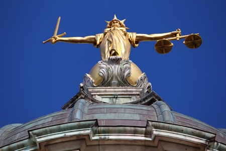 Justice statue. London, UK - Central Criminal Court also known as Old Bailey. Stock Photo